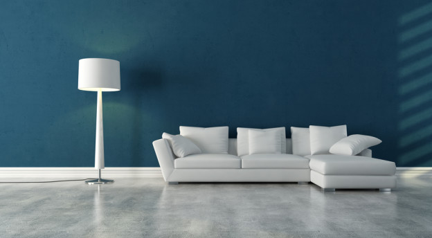 elegant modern white couch in a blue interior with concrete floor